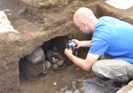Matt Naglak, a student in the U-M Interdepartmental Program in Classical Art and Archeology, records an exceptionally well-preserved ceramic finds from the niche of an infant tomb dating to the period of city formation, about 7th century B.C.