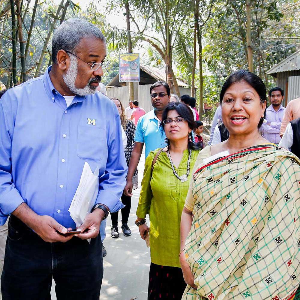 U-M School of Public Health Dean Martin Philbert listens to Afroz Huda, senior advisor for Foundation for Charitable Activities in Bangladesh. Image credit: M. Ponir Hussain