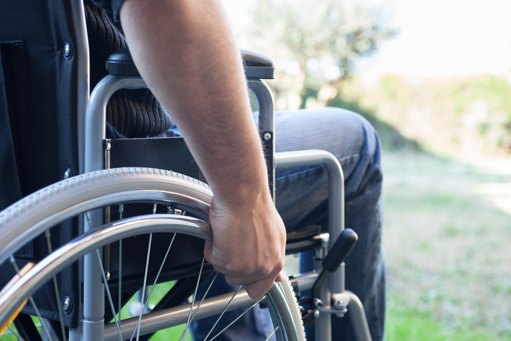 A man sits in a wheelchair. (stock image)