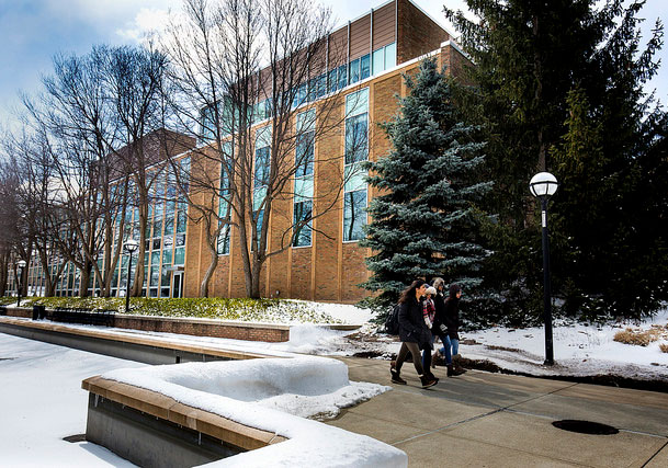 Students walk by the Nuclear Engineering Laboratory on North Campus of the University of Michigan in Ann Arbor, MI on March 14, 2017.   Photo: Joseph Xu/Multimedia Content Producer, University of Michigan - College of Engineering