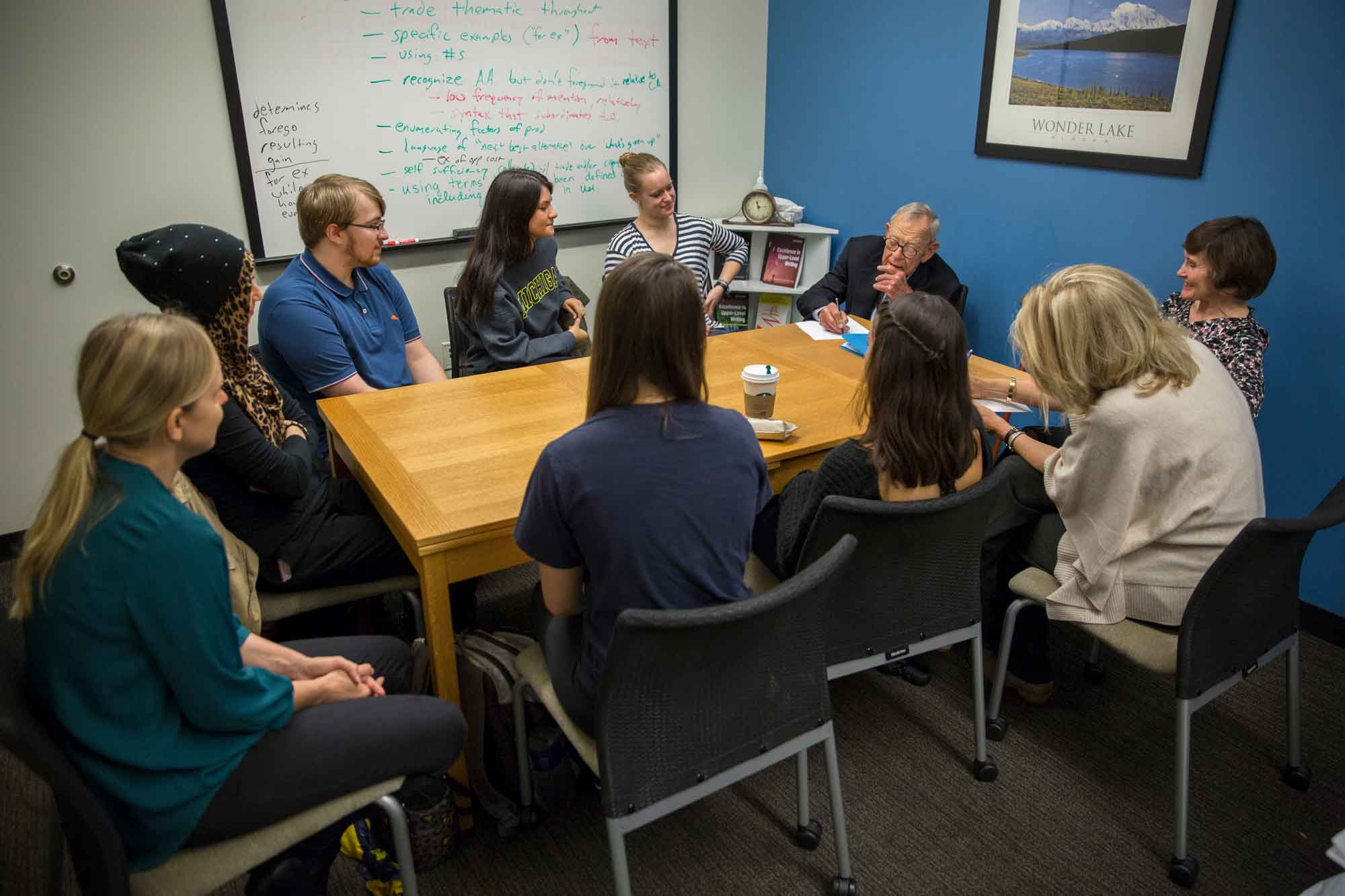 Writing fellows from the Sweetland Center for Writing discuss the M-Write tool with John W. Sweetland. The corporate leader and former business owner shared with students the importance of writing across professions, which is the basis of the center's work and is what spurred the M-Write program.