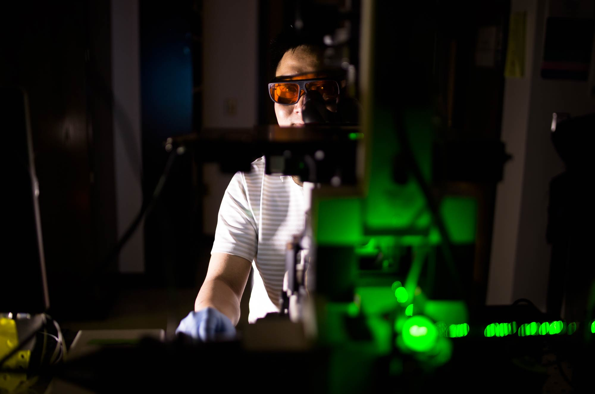 Yu-Chih Chen, a research scientist in electrical engineering and computer science, helped to develop a chip that can gently release individual cells, targeted with extremely short laser pulses. Image credit: Evan Dougherty, Michigan Engineering