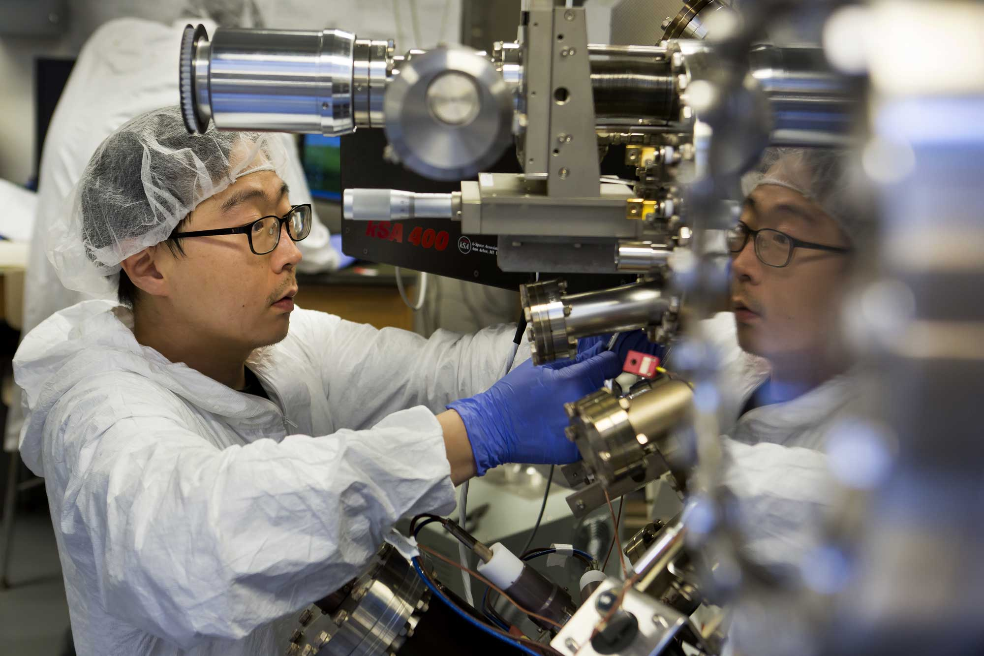Former materials science PhD student Sunyeol Jun prepares the molecular beam epitaxy apparatus that's used to make the nanoparticle-infused gallium nitride semiconductors. The semiconductors could boost LED efficiency by up to 50 percent, and even lead to invisibility cloaking devices. Image credit: Joseph Xu, Michigan Engineering