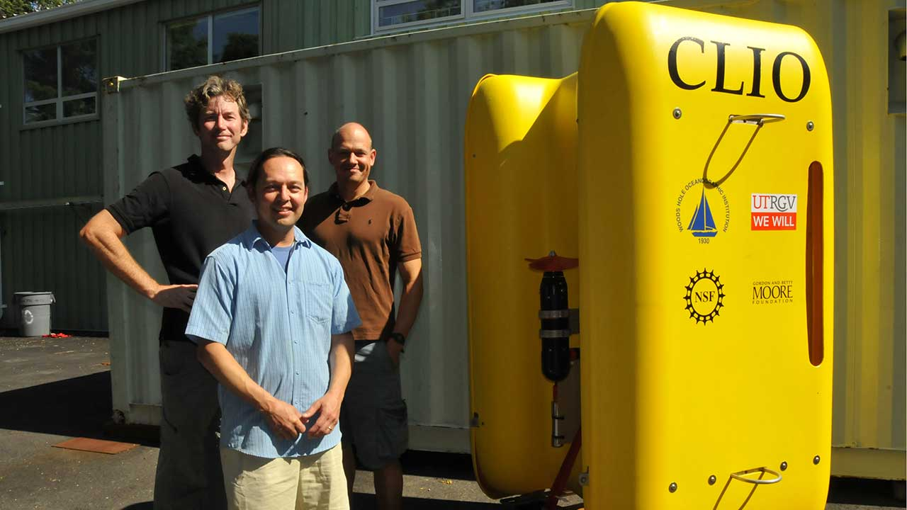 Principal investigators John Breier of UTRGV (left), Mak Saito (center) and Mike Jakuba of WHOI, with the AUV Clio— the world's first underwater vehicle designed specifically to collect both biological and chemical samples from the ocean water column. Image credit: Katherine Spencer Joyce, Woods Hole Oceanographic Institution