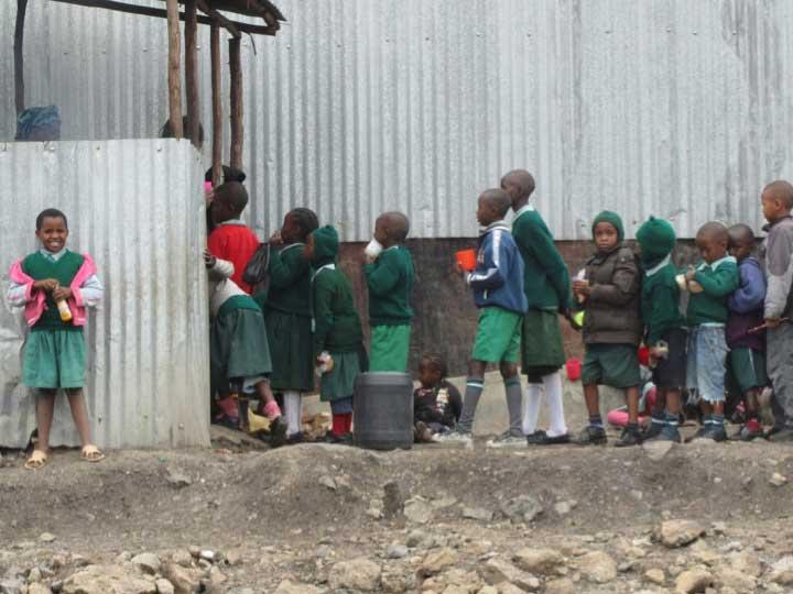 School childrens stand in line. Image credit: William Davidson Institute