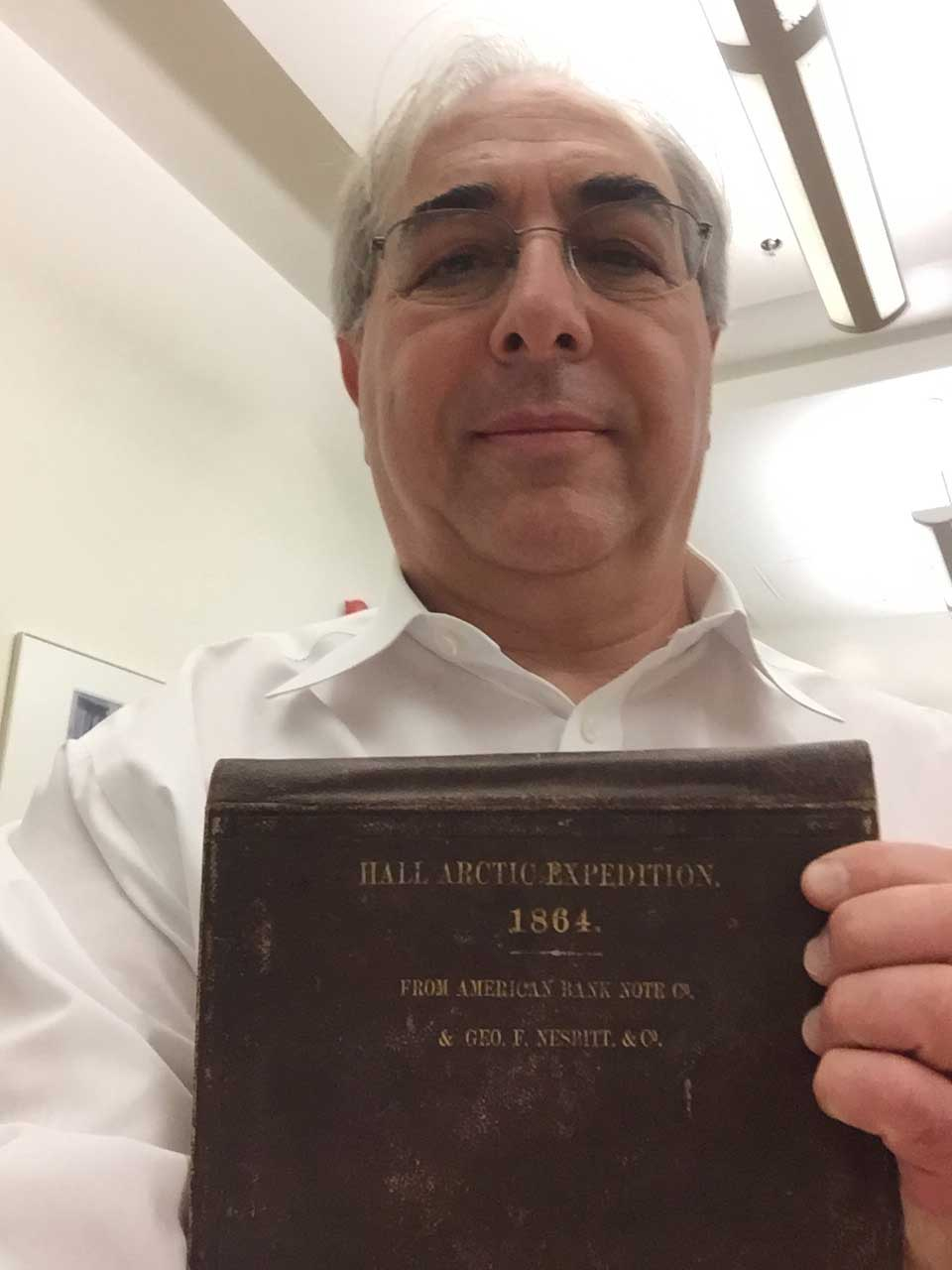 Russell Taichman holds a book detailing the 1864 Hall Arctic Expedition. Images courtesy: Russell Taichman