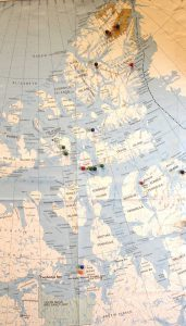 Pins on this map in Taichman's dental school office show some of the 16 Arctic locations he has visited. Although King William Island (the two pins nearest the bottom of the photo) is inside the Arctic Circle, some of Taichman's other trips have taken him much farther north in the remote polar region.