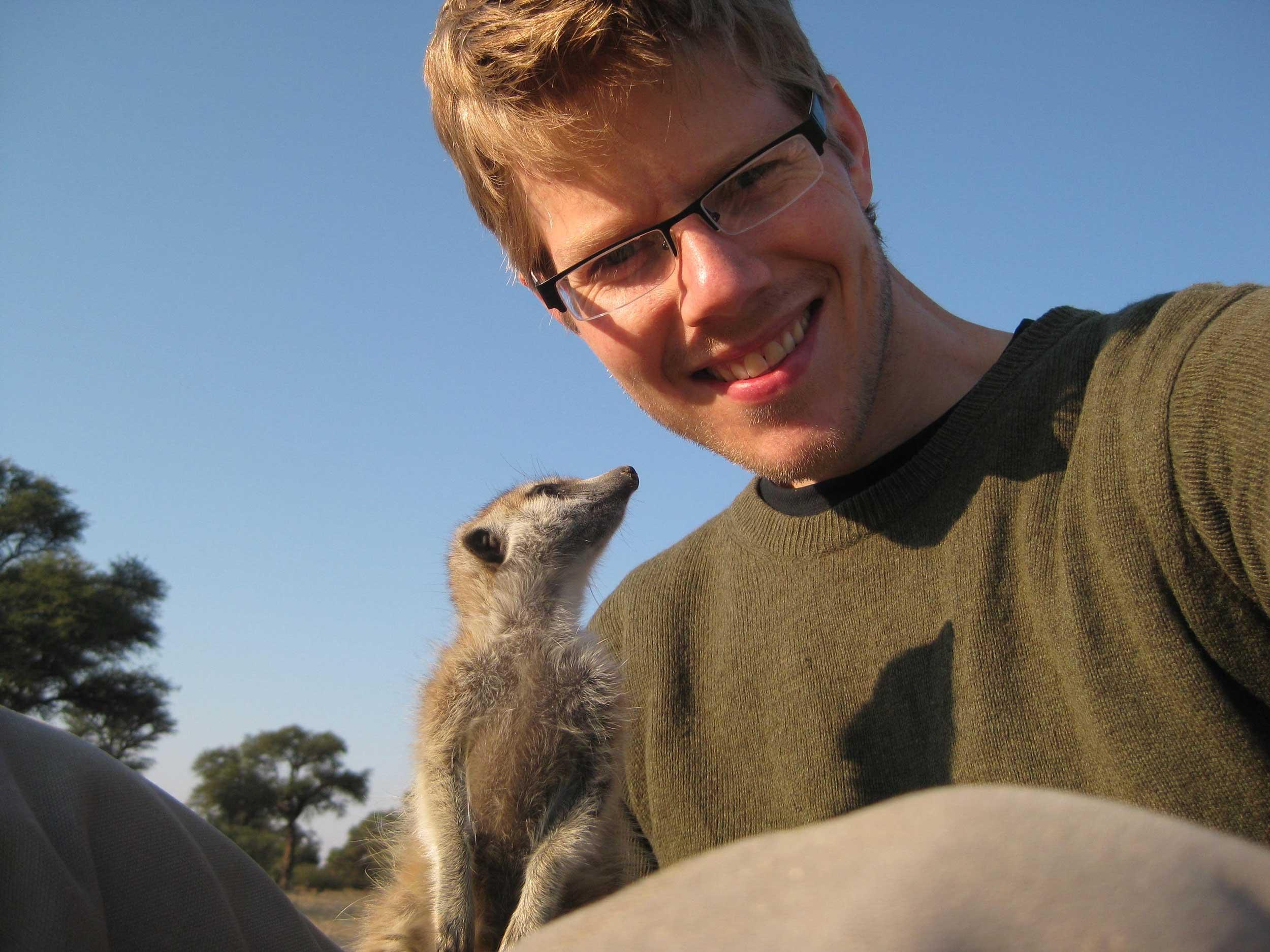 Ben Dantzer and meerkat. Image courtesy: Ben Dantzer