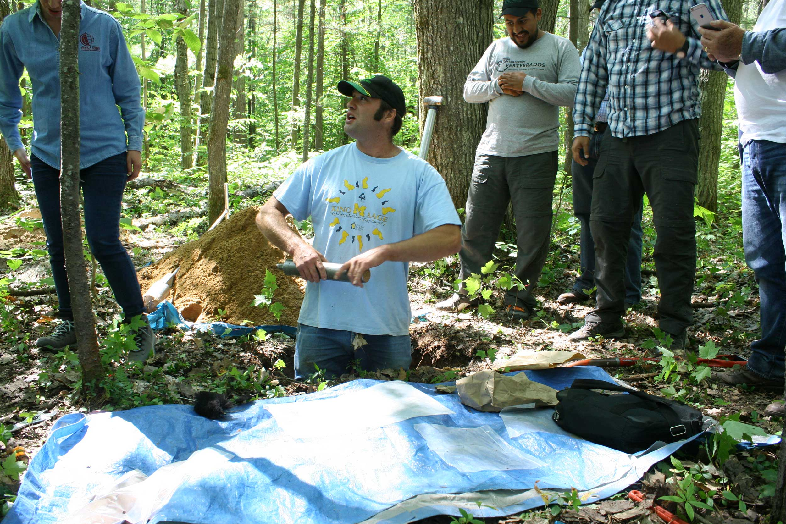 U-M ecologist and biogeochemist Luke Nave demonstrates methods to measure soil carbon during a July 2015 workshop at the University of Michigan Biological Station near Pellston. The annual workshop is held in partnership with the International Soil Carbon Network, the U.S. Forest Service, the U.S. Agency for International Development, and other domestic and international organizations. Image credit: Kailey Marcinkowski, Northern Institute of Applied Climate Science