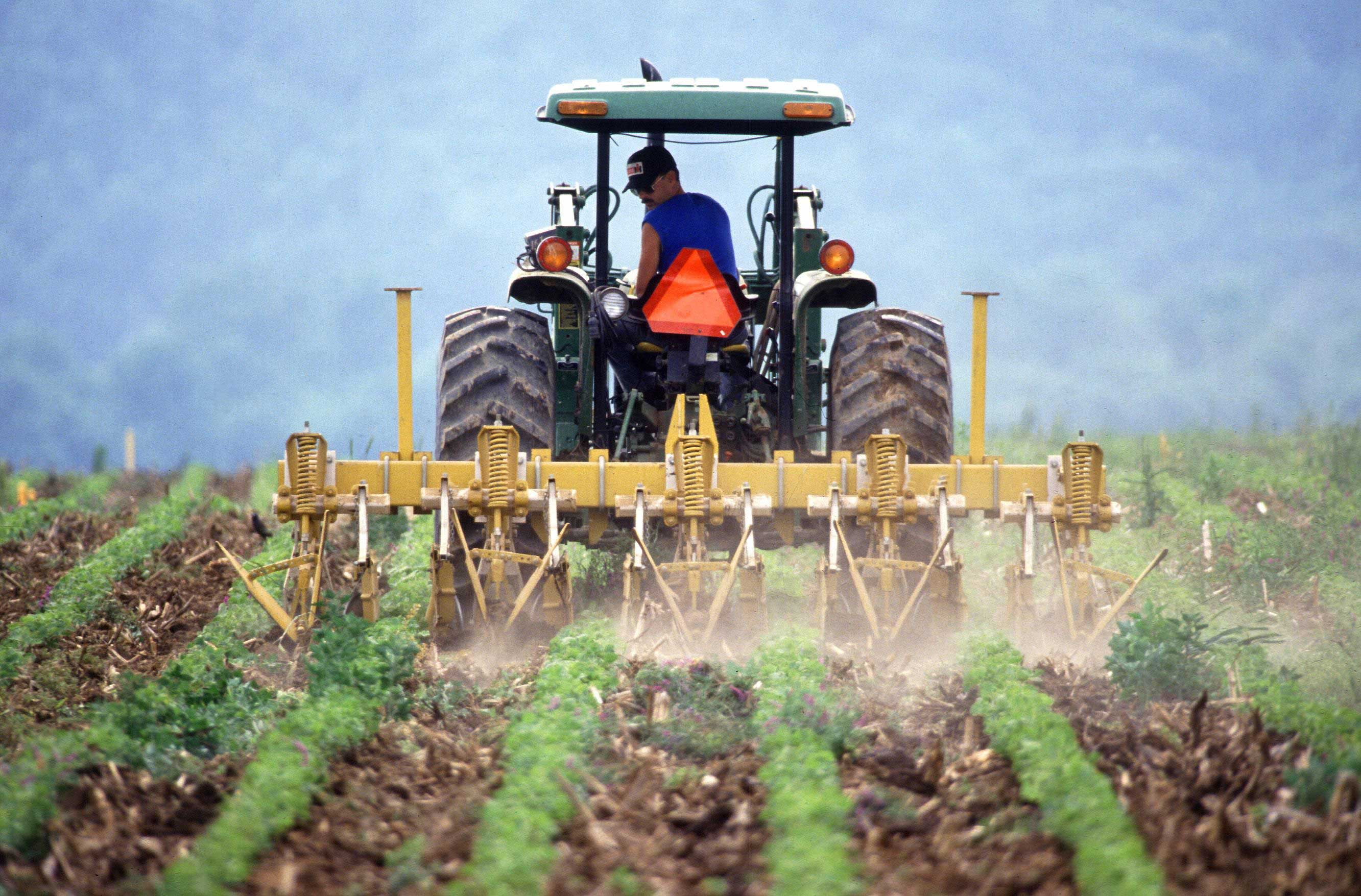 A farmer tilling soil. New research finds that reduced tillage and other land management practices could increase soil's carbon storage enough to offset future carbon emissions. Image credit: Keith Weller, U.S. Department of Agriculture