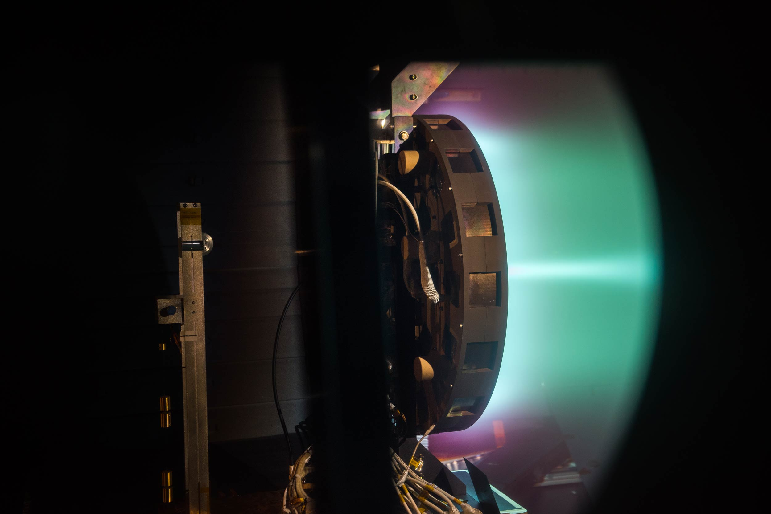 A side shot of the X3 firing at 50 kilowatts. Image credit: NASA