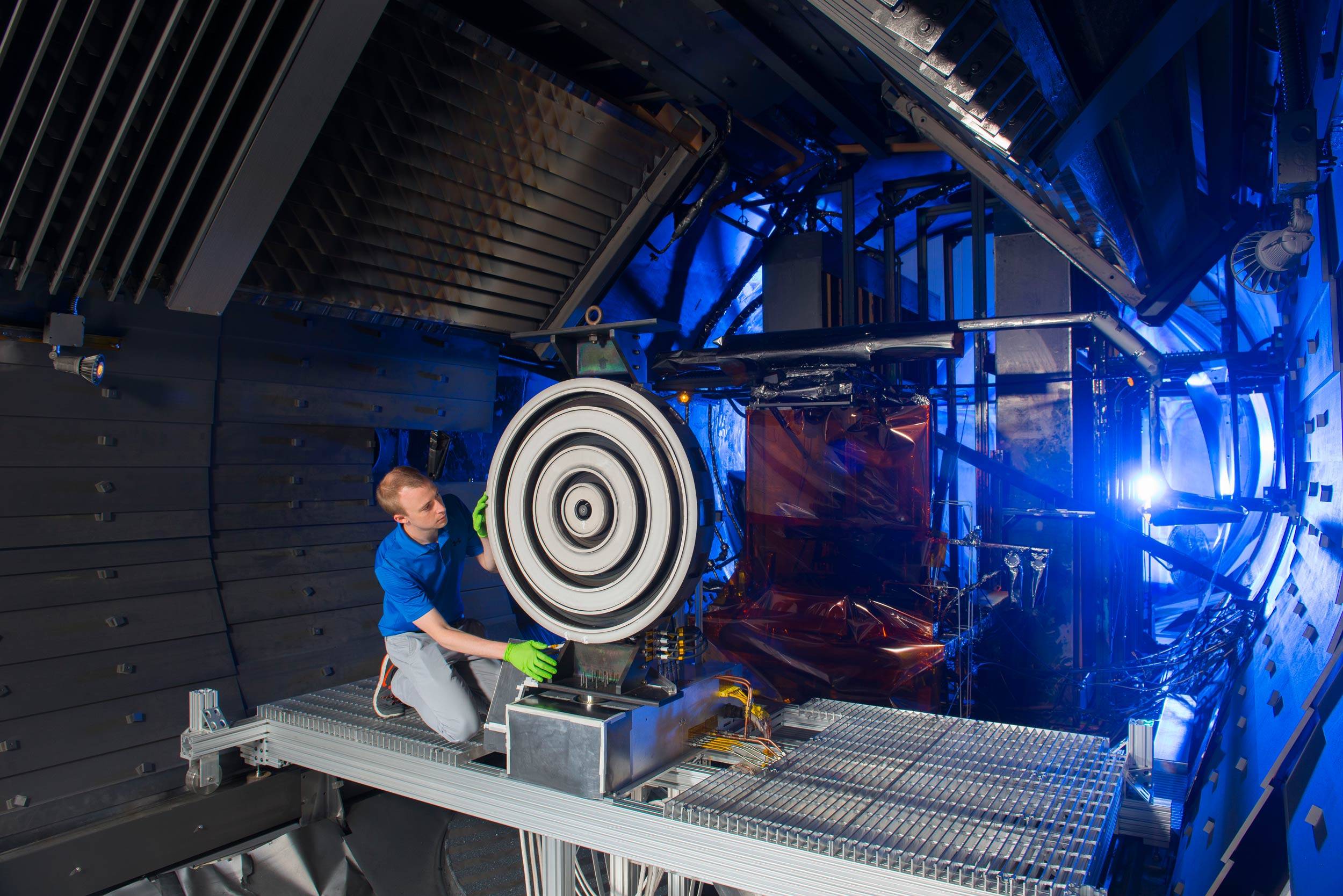 Scott Hall makes some final adjustments on the thruster before the test begins. Image credit: NASA