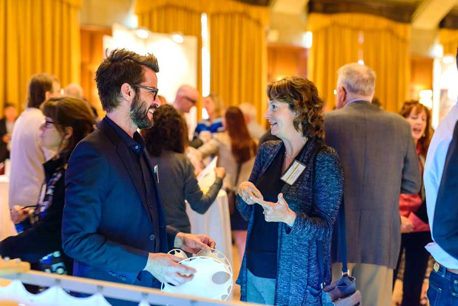 Two attendees chat at the 2016 Celebrate Innovation event. Image courtesy: U-M Tech Transfer
