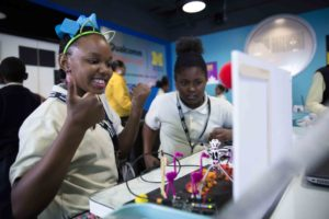 A fourth grader from Coleman A. Young Elementary School reacts to seeing her Arduino diorama project move for the first time as part of the Qualcomm Thinkabit Lab in the Michigan Engineering Zone. Image credit: Evan Dougherty