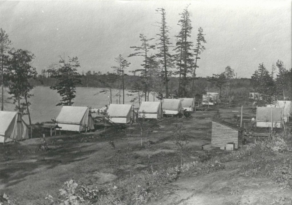 Residential tents at the University of Michigan Biological Station near Pellston, circa 1914, following a period of heavy logging and frequent wildfires. Ten women and four men were in the inaugural class of students in 1909. Image credit: U-M Bentley Historical Library