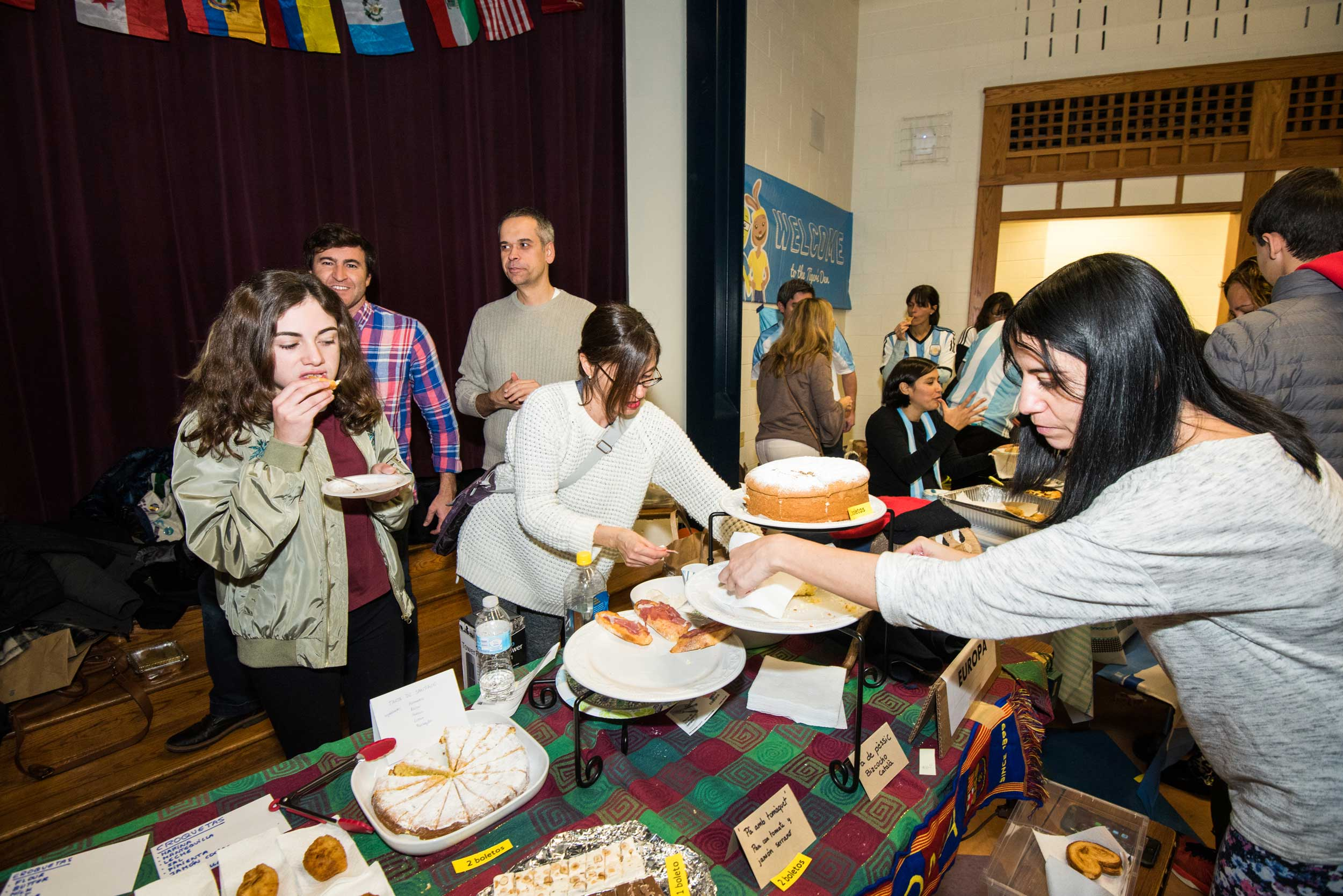 Parents and community members participate in En Nuestra Lengua's annual fundraiser featuring traditional foods from Spanish Speaking countries. The funds will go to pay in part for the program, which is free of charge to parents.