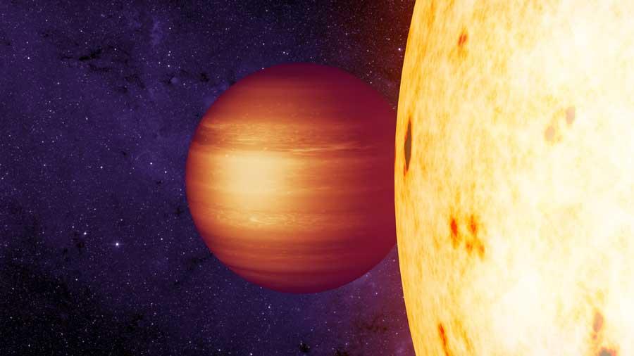 O conceito do artista mostra o exoplanet gaseoso CoRoT-2b em órbita, com um ponto de acesso para o oeste em torno de sua estrela hospedeira. Créditos: NASA / JPL-Caltech / T. Pyle (IPAC)