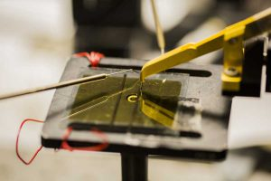 An organic solar cell testing inside the Randall Lab. University of Michigan researchers have found a way to coax electrons to travel much further than was previously thought possible in the materials often used for organic solar cells and other organic semiconductors. Image credit: Robert Coelius, Michigan Engineering