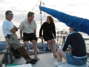Members of U-M paleoclimatologist Julia Cole's research team in the Galapagos in 2010. From left to right: Boat captain Lenin Cruz, Sandy Tudhope of the University of Edinburgh, Meriwether Wilson of the University of Edinburgh, and Diane Thompson, then at the University of Arizona and now at Boston University. Image credit: Julia Cole