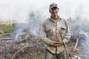 University of Michigan ecologist and biogeochemist Luke Nave during a prescribed fire at the U-M Biological Station in October 2017. Periodic burns at the station allow researchers to address critical questions about climate change and the long-term storage of carbon in forests and their soils. Image credit: Roger Hart, Michigan Photography.