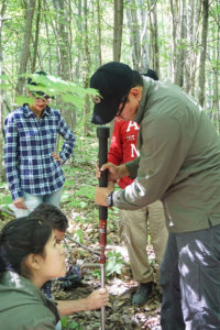 A participant in a June 2016 workshop at the U-M Biological Station learns techniques to measure soil carbon. Image credit: Kailey Marcinkowski, Northern Institute of Applied Climate Science.