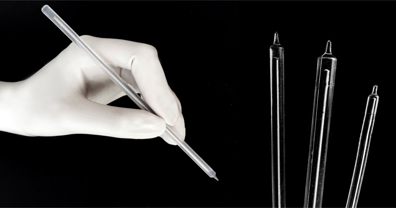 The latest design of the arterial everter is a flexible tool with a tapered silicone tip that can spread the artery onto the coupler's pins from almost any angle. The pins pierce through the artery and into the silicone without bending, and the tool's shaft can be angled as needed. Image credit: Carolyn McCarthy