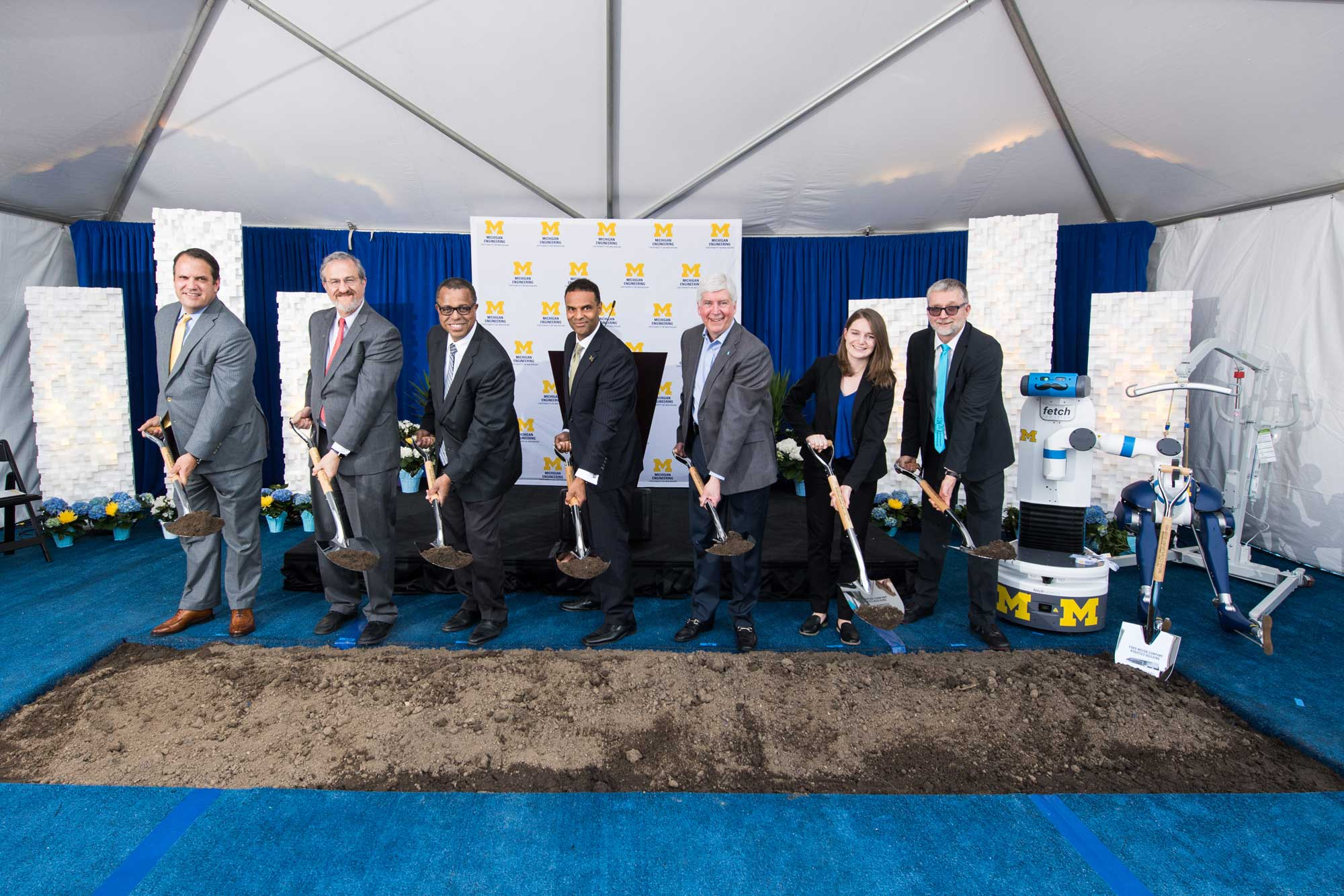 (Left to right) University of Michigan Regent Michael Behm; President Mark Schlissel; Ken Washington, vice president of research and advanced engineering and chief technology officer of Ford Motor Co.; Michigan Engineering Dean Alec D. Gallimore, Governor Rick Snyder; Katherine Skinner, doctoral student at Michigan Robotics; and Jessy Grizzle, director of the U-M Robotics Institute, break ground on the new Ford Motor Company Robotics Building. Image credit: Michigan Photography