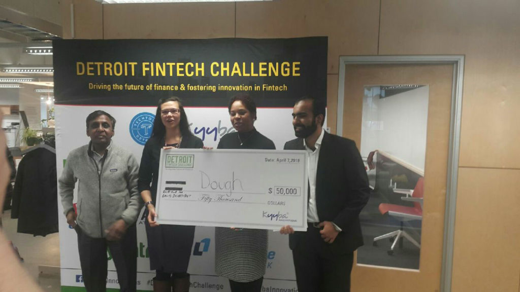 Catalina Kaiyoorawongs(second from left)andYahya Bajwa (right) team took home $50,000 after winning Detroit's Fintech Challengefor their startup Dough.Vic Heverle (left) and April Davis (second from right) mentored them through the process of creating Dough.