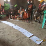 Using the picture card curriculum to teach family and child health to Sudanese women in Uganda refugee camps.