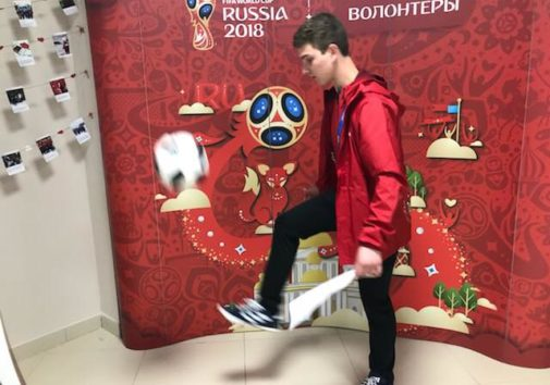 Marcus Cook kicking a soccer ball in Russia