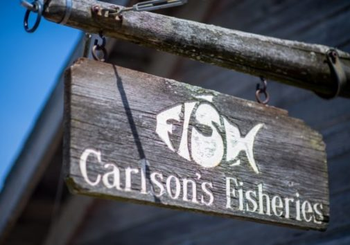 carlson's fisheries wood sign