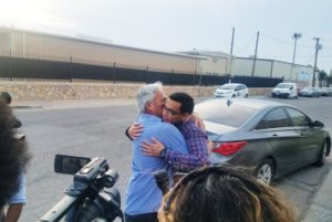Emilio Gutierrez-Soto and son Oscar embracing after being reunited