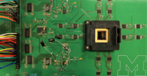 The memristor array situated on a circuit board.