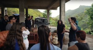 Amilcar Matos-Moreno, PhD candidate at the School of Public Health, gives directions to a group of students from the University of Michigan and Eastern Michigan University as they work to rebuild a house destroyed by Hurricane Maria.