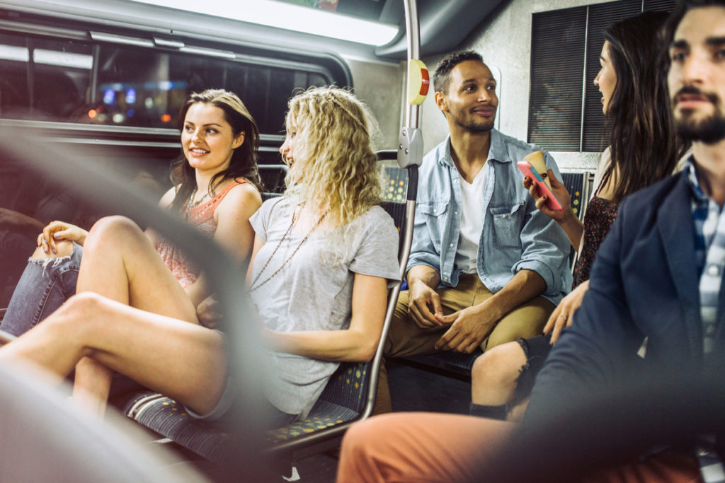 People riding city metro bus. iStock image