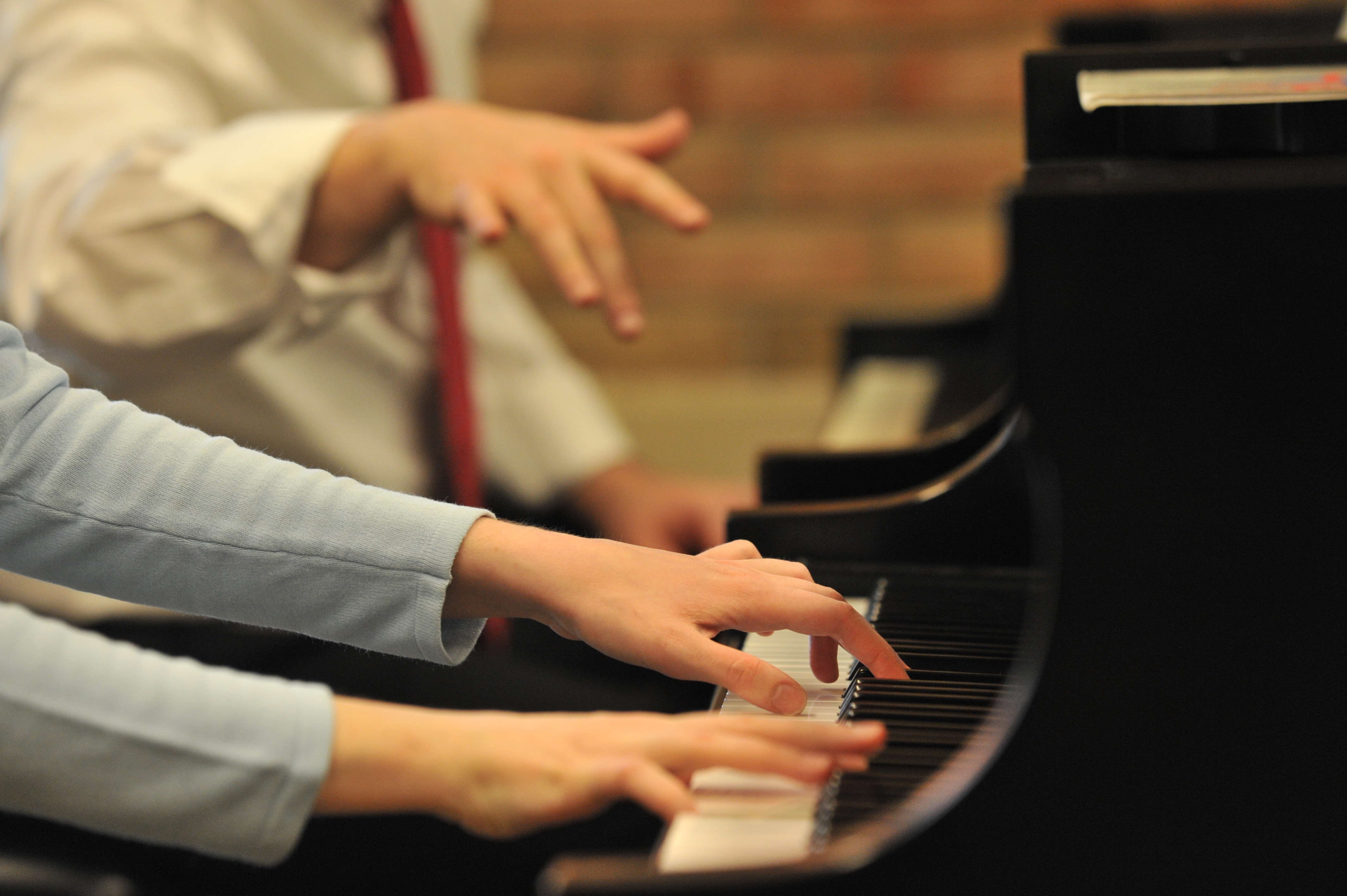 Hands on a piano. Image credit: Peter Smith, courtesy School of Music, Theatre & Dance