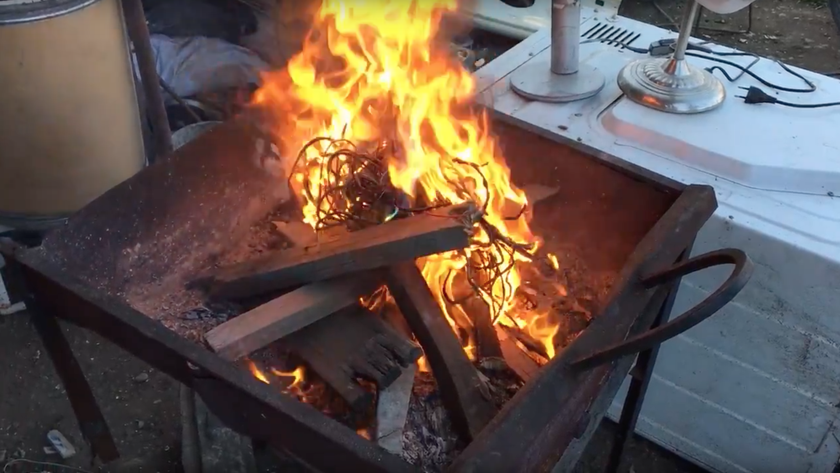 To get to the copper within, wires are burned in a grill in Santiago, Chile.