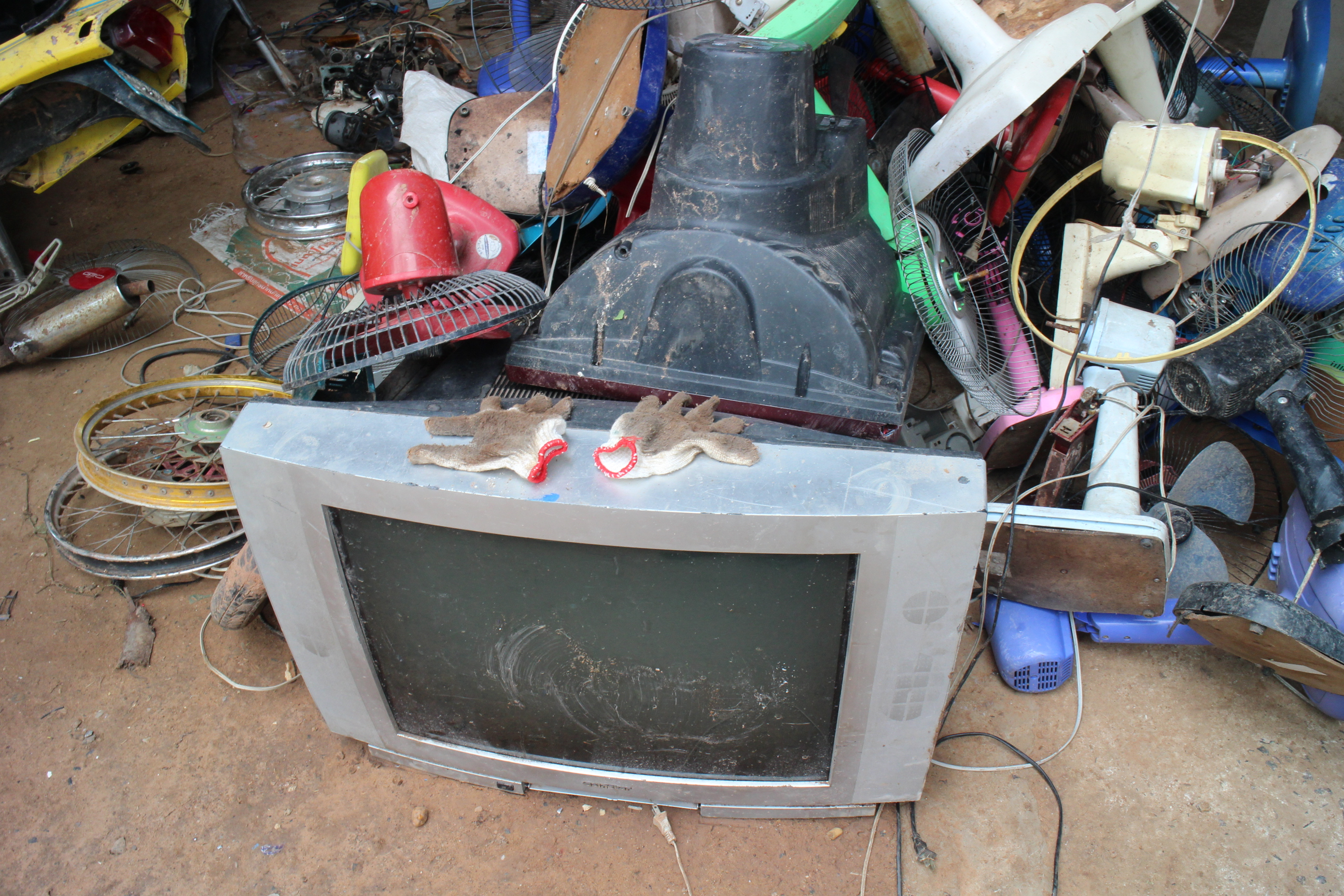 A pile of discarded electronic items that will be broken down to separate the valuable pieces within them.