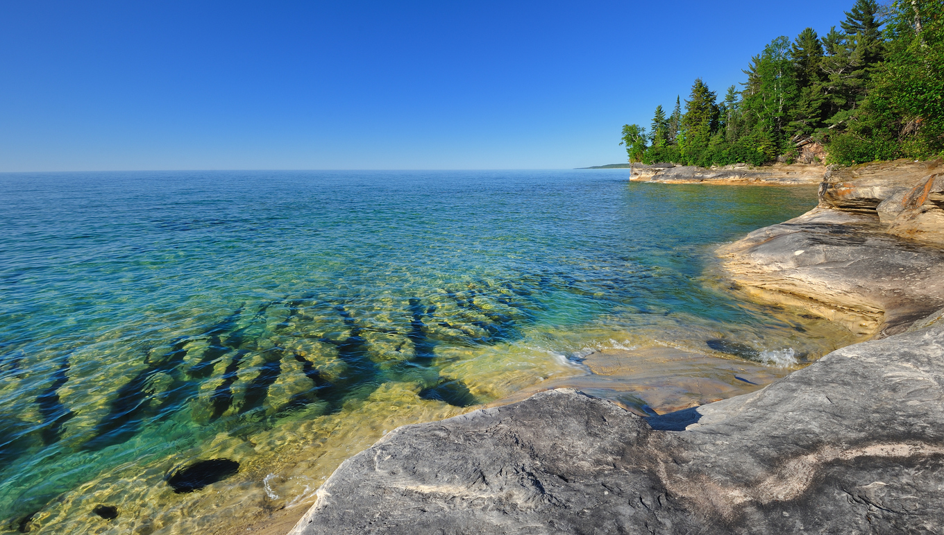 Pristine clear waters of Lake Superior Pictured Rocks National Lake-shore, near Munising, Michigan. Image credit: iStock