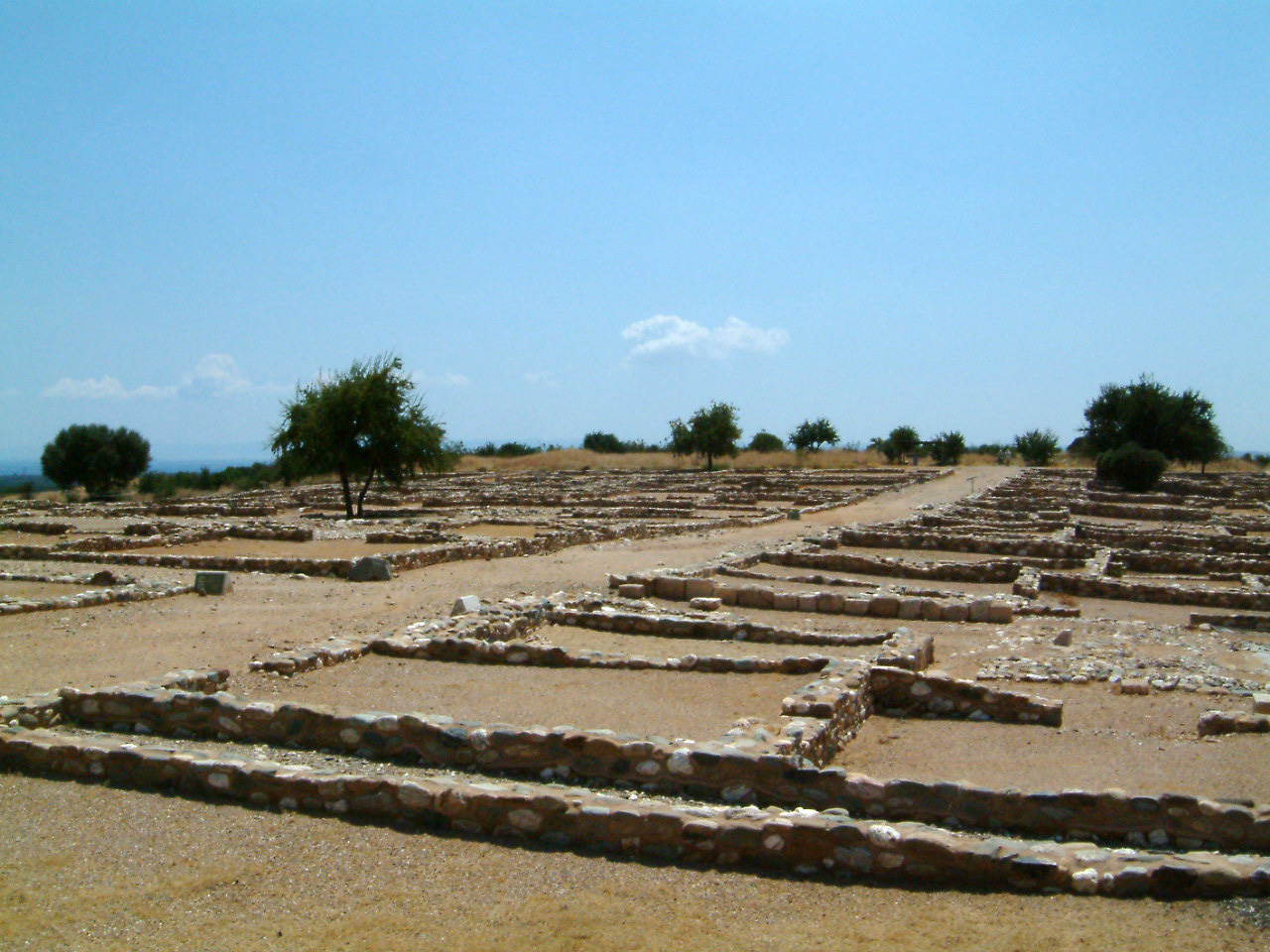 Olynthos North Hill in Greece; area excavated 1928–38 and now restored for visitors. Image credit: Lisa Nevett, Kelsey Museum of Archaeology