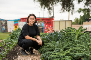 Anya Sirota, an associate professor of architecture at the University of Michigan Taubman College of Architecture and Urban Planning, has been working more than four years to help make the Oakland Avenue Urban Farm self-sufficient and sustainable. To buy the six acres the farm operates on, she studied speculators in Detroit and then spend two years gathering the property for the farm's land trust with help from investors and grants. Image credit: Michigan Photography
