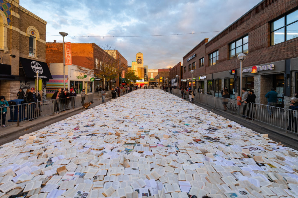 Books laid out open on Liberty Street in Ann Arbor.