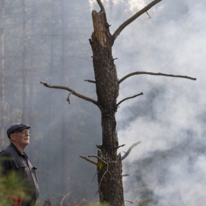 "U-M Biological Station Director Knute Nadelhoffer at the Oct. 10 prescribed fire. ""These burn plots are a time machine that allows us to look back at forests of different ages."""
