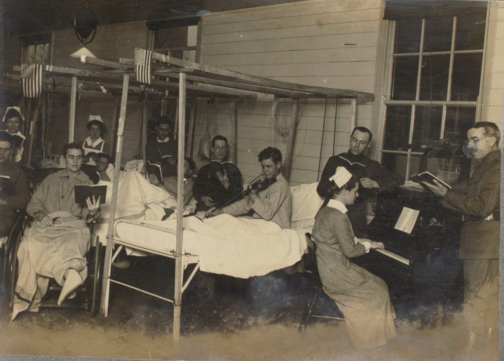 Singing at Base Hospital #29, London, England, 1918. World War I Surgeon's Album. Graphics Division. William L. Clements Library.