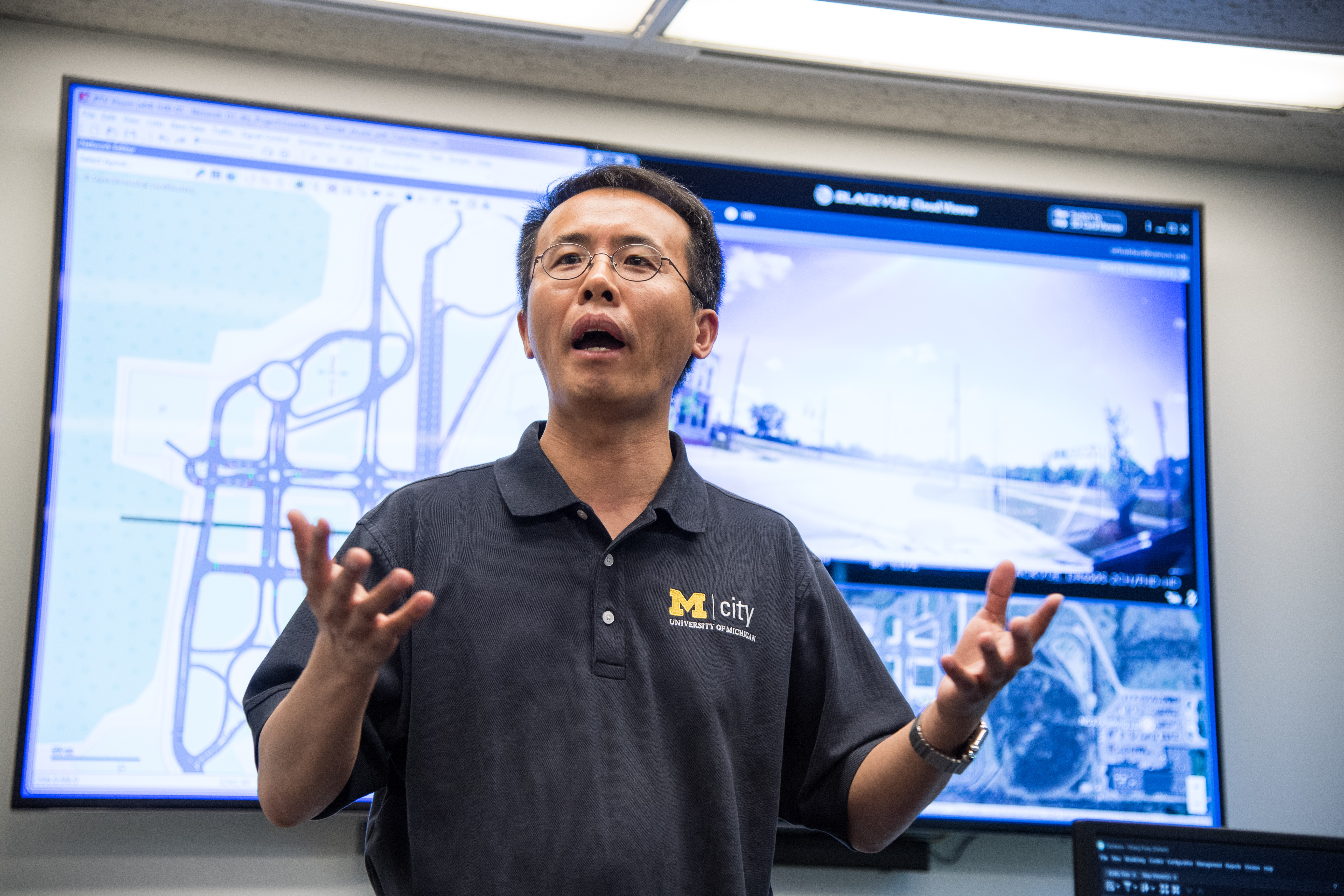 Henry Liu, professor of civil and environmental engineering and research professor at the U-M Transportation Research Institute, in the Michigan Traffic Lab at Mcity, where virtual connected vehicles coexist with real ones to accelerate testing of the technology. Image credit: Austin Thomason, Michigan Photography