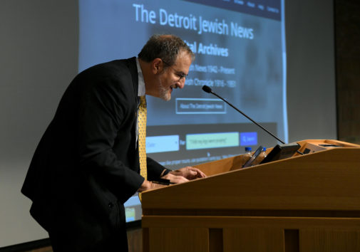 """U-M President Mark S. Schlissel conducts the first official search of the new Detroit Jewish News digital archive with the quote, """"I felt my legs were praying"""" on Nov. 5, 2018. Image credit: Lon Horwedel"""
