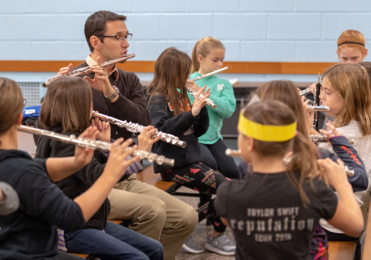 Joe McInchak (BM '02) is the High School band director at Tecumseh Public Schools. Photo by Roger Hart, Michigan Photography.