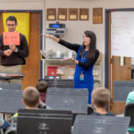 In addition to teaching middle and high school students, Kellie (BM '02) and Joe McInchak (BM '02) co-teach 5th grade at Tecumseh Public Schools. Photo by Roger Hart, Michigan Photography.