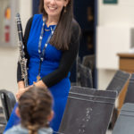 Kellie (BM '02) McInchak teaches 5th,–8th grade band for Tecumseh Public Schools. Photo by Roger Hart, Michigan Photography.