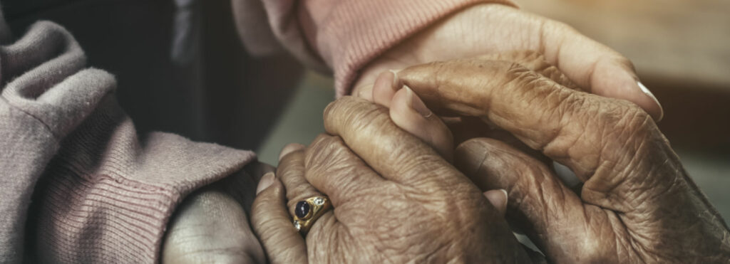 Holding elderly hands. Image courtesy: Wayne State University